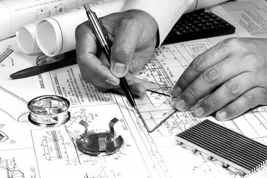 a mechanical engineer working on a blueprint